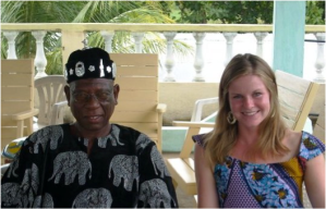 Sunny Widmann sits with the newly crowned chief of her host village (Ati-Atovou, Togo), Chief Akoussah in 2008.