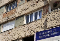 A bullet riddled building is seen before being repaired under a European Union reconstruction program in Mostar March 29, 2012. [Source: http://reut.rs/HO4sZF]
